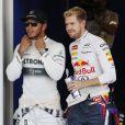 Lewis Hamilton et Sebastian Vettel dans le paddock du Grand Prix du Japon à Suzuka le 13 octobre 2013