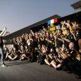 Romain Grosjean dans le paddock du Grand Prix du Japon à Suzuka le 13 octobre 2013 après sa belle troisième place