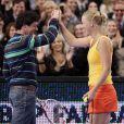 Rory McIlroy et Caroline Wozniacki, complices au Madison Square Garden de New York lors d'un match exhibition le 5 mars 2012