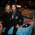 L'artiste Karl Lagasse et Isabelle Funaro, à l'Automobile Club de France, à Paris, à l'occasion de la soirée de vente aux enchères au profit de l'association AMFE, le mercredi 13 novembre 2013.