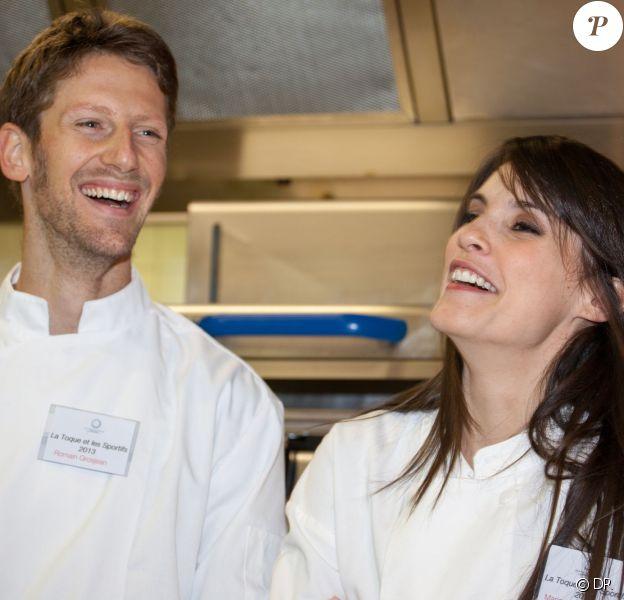 """Romain Grosjean et son épouse Marion Jollès lors de la 17e éditionde la soirée """"La Toque et les sportifs"""" aux Gorges de Pennafort dans le Var le 26 novembre 2013."""