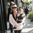 Kourtney Kardashian et sa fille Penelope ont profité d'une après-midi entre filles à Beverly Hills, avec Kim Kardashian. Le 16 décembre 2013.