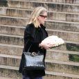Catherine Deneuve lors des obsèques de Kate Barry en l'église Saint-Roch à Paris le 19 décembre 2013