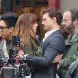 Jamie Dornan et Dakota Johnson sur le tournage du film Fifty Shades of Grey à Vancouver, le 19 décembre 2013.