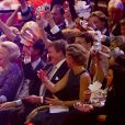 La princesse Beatrix, le premier ministre Mark Rutte, le roi Willem-Alexander et la reine Maxima dans l'ambiance au premier rang du ''kop'' de la famille royale. La princesse Beatrix des Pays-Bas recevait le 1er février 2014 au Ahoy de Rotterdam, en présence de son héritier le roi Willem-Alexander et de la reine Maxima ainsi que de l'ensemble de la famille royale, un vibrant hommage en marque de gratitude pour ses 33 ans de règne, de 1980 à son abdication le 30 avril 2013 au profit de son fils Willem-Alexander.