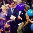 La princesse Beatrix et le premier ministre Mark Rutte hilares lors de la soirée. La princesse Beatrix des Pays-Bas recevait le 1er février 2014 au Ahoy de Rotterdam, en présence de son héritier le roi Willem-Alexander et de la reine Maxima ainsi que de l'ensemble de la famille royale, un vibrant hommage en marque de gratitude pour ses 33 ans de règne, de 1980 à son abdication le 30 avril 2013 au profit de son fils Willem-Alexander.