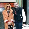 La créatrice de bijoux Yazbukey et Lucien Pages lors du défilé Sonia Rykiel automne-hiver 2014-15 à la Salle Wagram. Paris, le 28 février 2014.