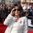 """Joan Collins aux """"The Prince's Trust & Samsung Celebrate Success Awards"""" à l'Odéon à Leicester Square à Londres, le 12 mars 2014."""