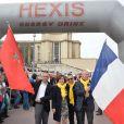 Chakib Ben Moussa (ambassadeur du Maroc en France), Danièle Evenou, Jean-Marc Généreux et Philippe Wahl (président du groupe La Poste) lors du départ de la 24ème édition du Rallye Aïcha des Gazelles du Maroc au Trocadéro à Paris, le 15 mars 2014.
