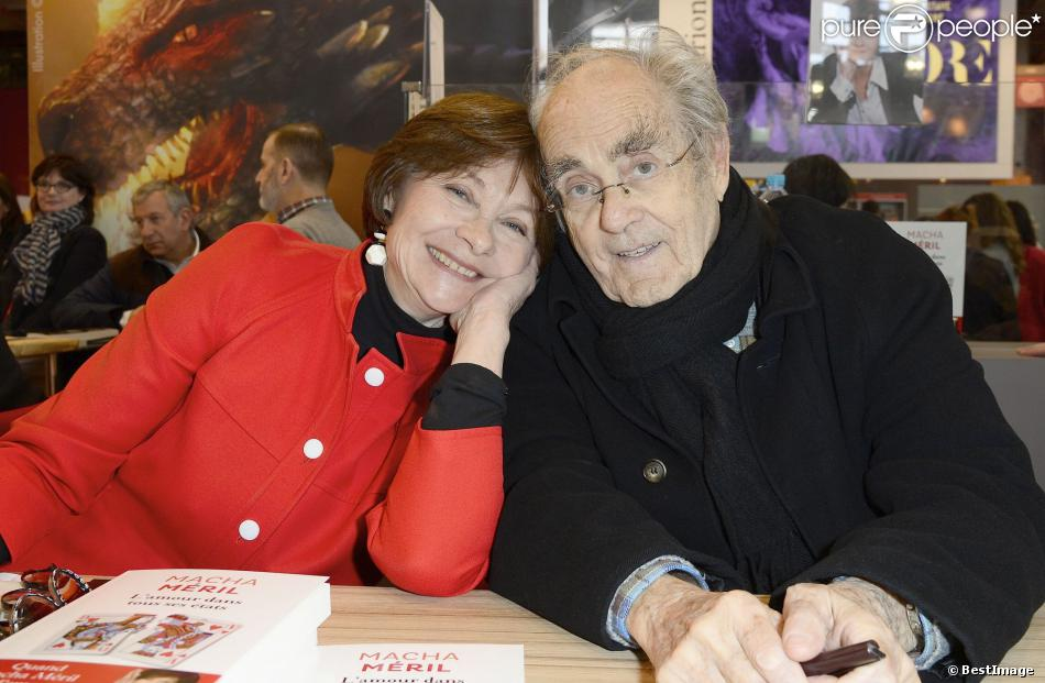 Macha Méril et son fiancé Michel Legrand au 34e Salon du livre de Paris, Porte de Versailles, le 23 mars 2014.