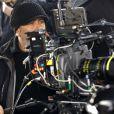 Luc Besson derrière la caméra pour le film Lucy (Photo : Jessical Forde)