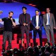 Mark Wahlberg, Jerry Ferrara, Adrian Grenier et Kevin Dillon sur la scène des MTV Movie Awards 2014, le 13 avril 2014.