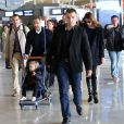 Nicolas Sarkozy, Carla-Bruni Sarkozy et leur fille Giulia à l'aéroport de Roissy le 30 avril 2014.