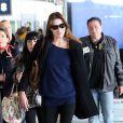 Nicolas Sarkozy, Carla-Bruni Sarkozy et leur fille Giulia arrivent à l'aéroport de Roissy le 30 avril 2014.