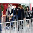 Nicolas Sarkozy, Carla-Bruni Sarkozy avec leur fille Giulia arrivent à l'aéroport de Roissy le 30 avril 2014.