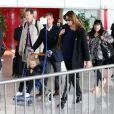Nicolas Sarkozy, Carla-Bruni Sarkozy et leur fille Giulia à leur arrivée à l'aéroport de Roissy le 30 avril 2014.