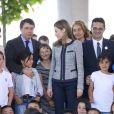 La princesse Letizia d'Espagne s'est rendue le 30 avril 2014 à l'école Maria Moliner de Villanueva de la Canada, à Madrid, dans le cadre de ses missions pour la FEDER, la Fédération espagnole des maladies rares.