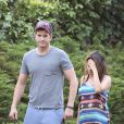 Exclusive. Expectant couple Ashton Kutcher and Mila Kunis took their two dogs out for a walk on a sunny afternoon in the Hollywood Hills, Los Angeles, CA, USA on May 1, 2014. Mila showed off her diamond engagement ring as well as a slight baby bump beneath her Southwest patterned dress. Ashton, who was dressed for a workout, kept a protective watch over his fiancee as they strolled through a residential neighborhood with their pets. Photo by GSI/ABACAPRESS.COM02/05/2014 - Los Angeles