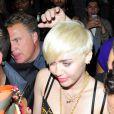 """Miley Cyrus quittant le club """"Madame Jojo"""" à Londres le 8 mai 2014."""