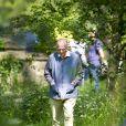 La reine Elizabeth II a profité le 17 mai 2014 du Royal Windsor Horse Show, auquel elle est arrivée au volant de son Range Rover, avec son époux le duc d'Edimbourg