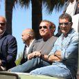 """Kelsey Grammer, Arnold Schwarzenegger, Antonio Banderas, Glen Powell - Les acteurs du film """"Expendables 3"""" arrivent à bord d'un char militaire devant l'hôtel Carlton pour le photocall du film dans le cadre du 67ème festival du film de Cannes, le 18 mai 2014."""