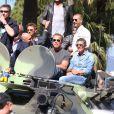 """Arnold Schwarzenegger, Antonio Banderas, Glen Powell - Les acteurs du film """"Expendables 3"""" arrivent à bord d'un char militaire devant l'hôtel Carlton pour le photocall du film dans le cadre du 67ème festival du film de Cannes, le 18 mai 2014."""
