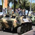 """Sylvester Stalone, Mel Gibson, Jason Statham, Harrison Ford - Les acteurs du film """"Expendables 3"""" arrivent à bord d'un char militaire devant l'hôtel Carlton pour le photocall du film dans le cadre du 67ème festival du film de Cannes, le 18 mai 2014."""