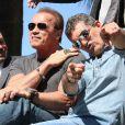 """Randy Couture, Arnold Schwarzenegger, Antonio Banderas - Les acteurs du film """"Expendables 3"""" arrivent à bord d'un char militaire devant l'hôtel Carlton pour le photocall du film dans le cadre du 67ème festival du film de Cannes, le 18 mai 2014."""