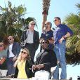 """Dolph Lundgren, Jason Statham, Harrison Ford, Mel Gibson, Sylvester Stalone, Ronda Rousey, Wesley Snipes - Les acteurs du film """"Expendables 3"""" arrivent à bord d'un char militaire devant l'hôtel Carlton pour le photocall du film dans le cadre du 67ème festival du film de Cannes, le 18 mai 2014."""