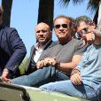 """Kelsey Grammer, Randy Couture, Arnold Schwarzenegger, Antonio Banderas - Les acteurs du film """"Expendables 3"""" arrivent à bord d'un char militaire devant l'hôtel Carlton pour le photocall du film dans le cadre du 67ème festival du film de Cannes, le 18 mai 2014."""