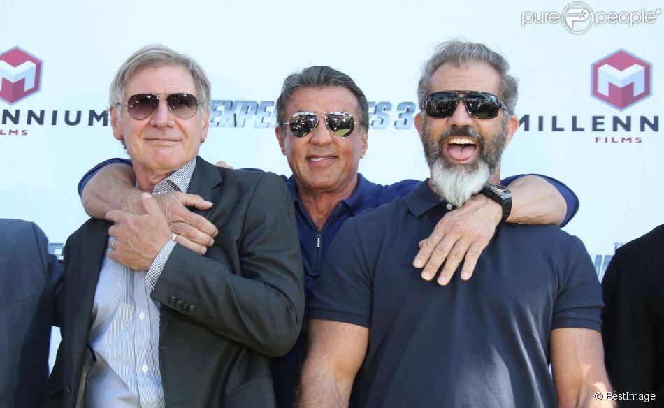"""Sylvester Stallone entre Harrison Ford et Mel Gibson - Les acteurs du film """"Expendables 3"""" au photocall du film devant le Carlton dans le cadre du 67e festival du film de Cannes, le 18 mai 2014."""