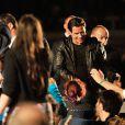 John Travolta lors de la projection de Pulp Fiction au Cinéma de la plage durant le Festival de Cannes, 20 ans après sa Palme d'or, le 23 ami 2014