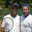 Sylvain Wiltord et Cyril Hanouna à Roland-Garros pour participer au Trophée des personnalités, le vendredi 6 juin 2014.