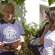 Raymond Domenech et Estelle Denis, à Roland-Garros pour participer au Trophée des personnalités, le vendredi 6 juin 2014.