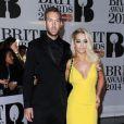 Calvin Harris et Rita Ora aux Brit Awards 2014. Londres, le 19 février 2014.