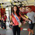 Miss France 2014, Flora Coquerel fait un entraînement de TRX suspension avec Randy Hetrick, chez CMG au Club Waou Bercy à Paris, le 17 juin 2014