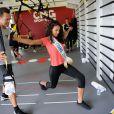 Flora Coquerel fait un entraînement de TRX suspension avec Randy Hetrick, chez CMG au Club Waou Bercy à Paris, le 17 juin 2014