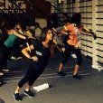 Karine Ferri et Flora Coquerel suivent un entraînement de TRX suspension avec Randy Hetrick, chez CMG au Club Waou Bercy à Paris, le 17 juin 2014/