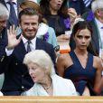 David et Victoria Beckham assistent à la finale homme, à Wimbledon, entre Roger Federer et Novak Djokovic, le 6 juillet 2014.