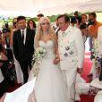 L'homme d'affaires Richard Lugner épouse sa jeune compagne Cathy Schmitz lors d'une cérémonié à Velden am Wortersee, en Autriche. Le 1 août 2014.