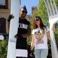Djibril Cissé et sa compagne à Disneyland Paris, le 21 juin 2014.