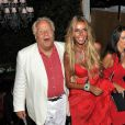 Massimo Gargia, en charmante compagnie, fête les 62 ans de Fawaz Gruosi au Billionaire. Porto Cervo, le 8 août 2014.
