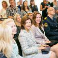 La reine Silvia de Suède assiste à l'ouverture du centre Barnahus d'aide à l'enfance à Stockholm, le 27 août 2014.