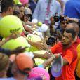 Jo-Wilfried Tsonga sollicité lors de son troisième tour de l'US Open face à Pablo Carreno Busta à l'USTA Billie Jean King National Tennis Center de New York le 30 août 2014
