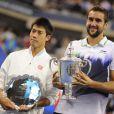 Marin Cilic et Kei Nishikori après la finale de l'US Open à New York le 8 septembre 2014.