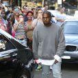 Kim Kardashian et Kanye West en pleine séance shopping à Sydney, le 13 septembre 2014.