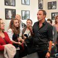 Exclusif - Nikos Aliagas présente son exposition photos dans les locaux d'Europe 1 à l'occasion des journées du Patrimoine à Paris, le 21 septembre 2014.