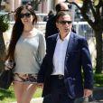 L'ancien ministre Eric Besson et sa femme Yasmine se promenant sur la Croisette en plein Festival de Cannes le 23 mai 2013