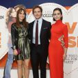 Suki Waterhouse, Sam Claflin et Lily Collins à Londres le 6 octobre 2014.