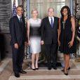 Charlene de Monaco, enceinte de jumeaux, et le prince Albert avec le président Barack Obama et la First Lady Michelle Obama lors d'une réception à New York en septembre 2014